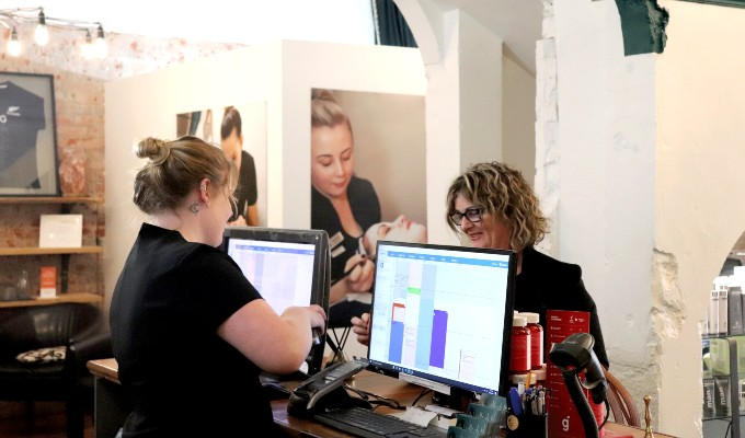 Customer checking out at the front desk of a spa salon